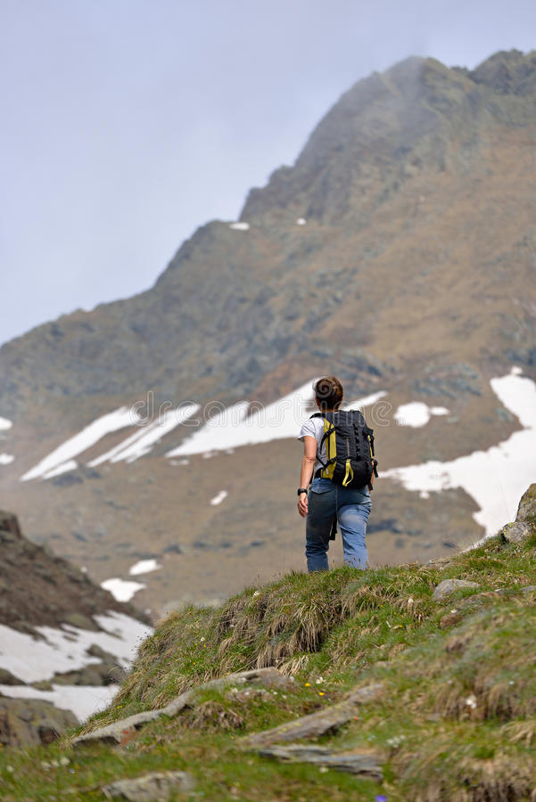 Hiker on the way up royalty free stock photography