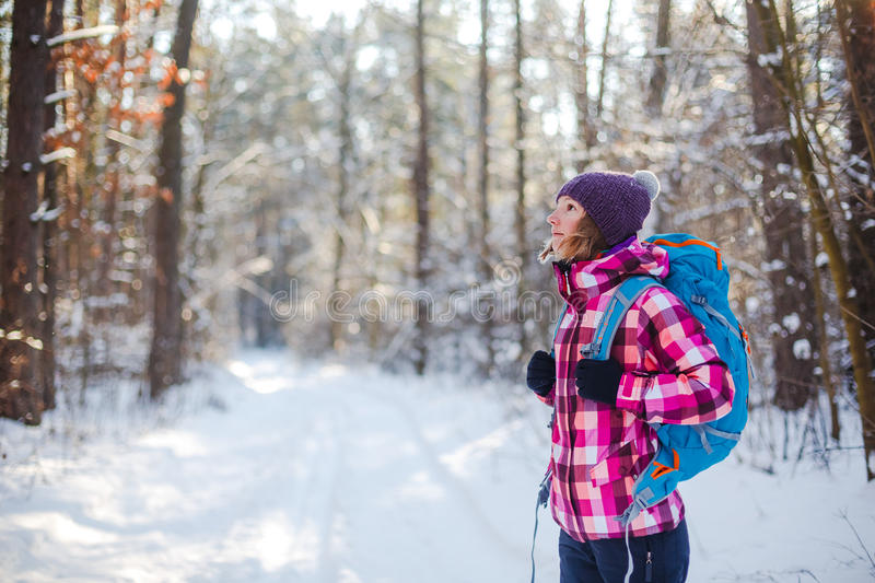 Hiker in winter forest. Sport, inspiration and travel. Young happy woman cross country walking in mountains on snow winter day stock photos
