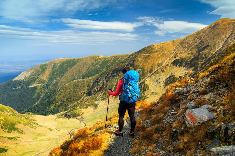 Hiker woman with backpack in Fagaras mountains, Transylvania, Romania, Europe royalty free stock image