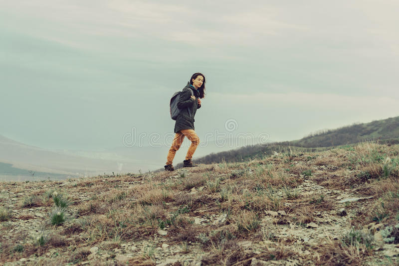 Hiker woman climbing in the mountain royalty free stock images
