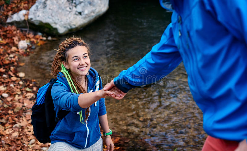 Hiker woman getting help stock photos