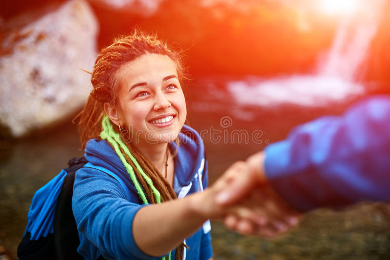 Hiker woman getting help royalty free stock images
