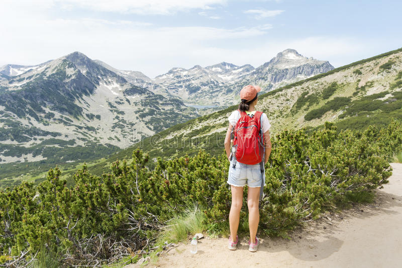 Hiker woman in a high mountain ,looking the panorama stock photo