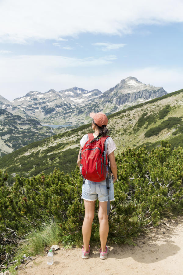 Hiker woman in a high mountain ,looking the panorama royalty free stock photo