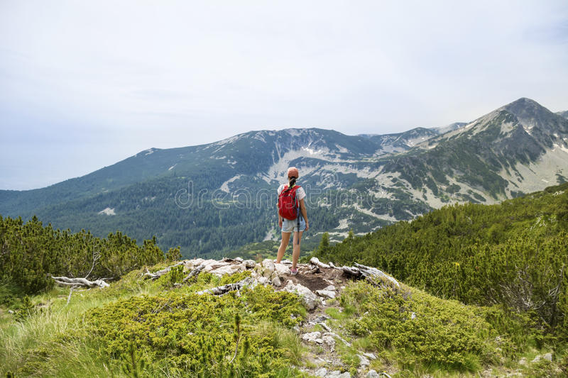 Hiker woman in a high mountain ,looking the panorama stock photography