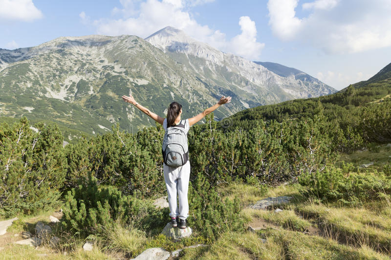 Hiker woman in a high mountain ,looking the panorama royalty free stock photography