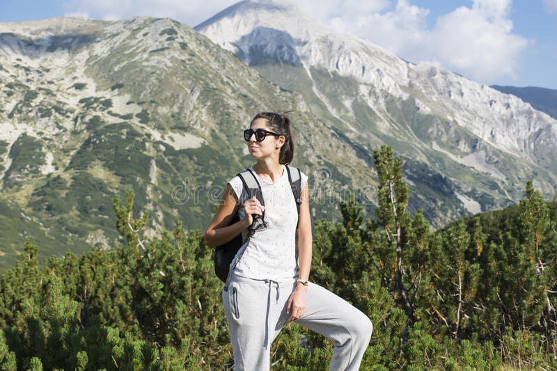 Hiker woman in a high mountain ,looking the panorama stock photos