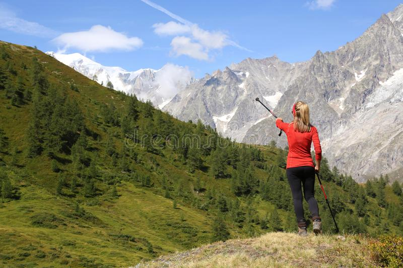 Hiker woman pointing the Mont Blanc royalty free stock photography