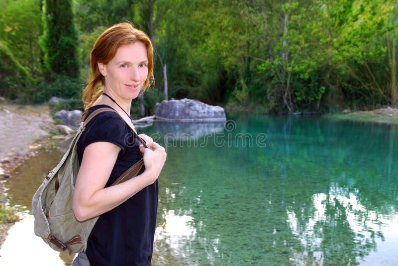 Hiker woman smiling backpack nature river lake