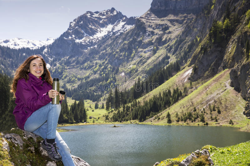 Hiker woman taking a break royalty free stock images