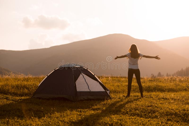 Hiker woman on top of mountain with open hands stock photo