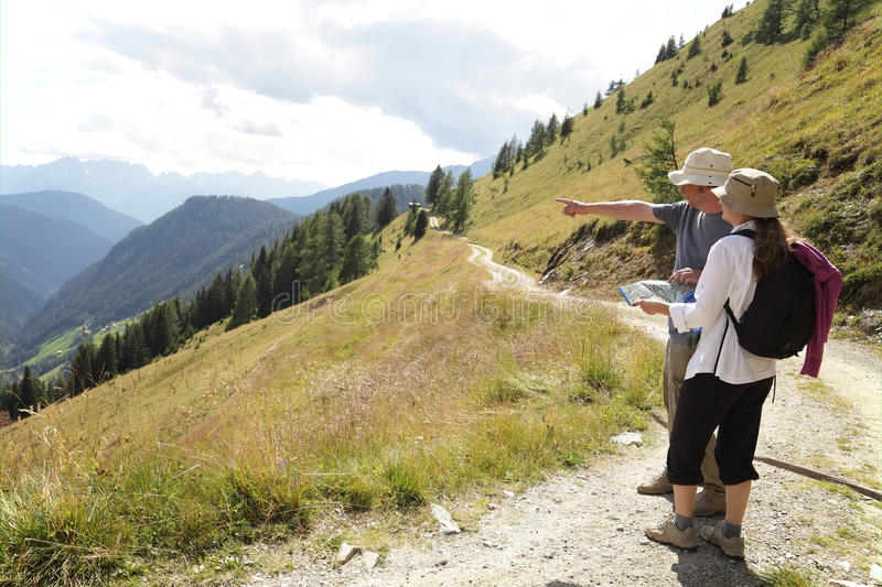 Hikers on alpine trail stock photography