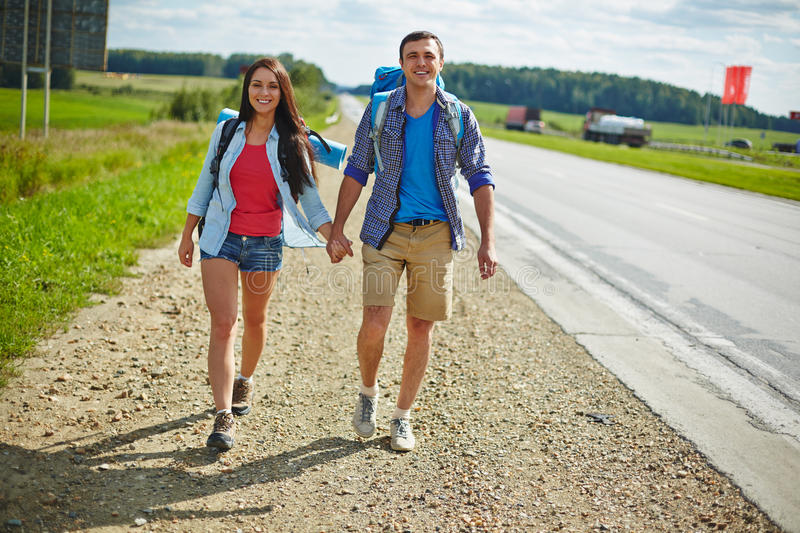 Hikers with backpacks royalty free stock image