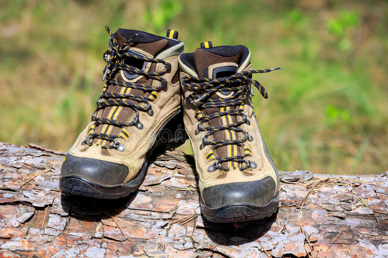 Hikers boots on log stock photos