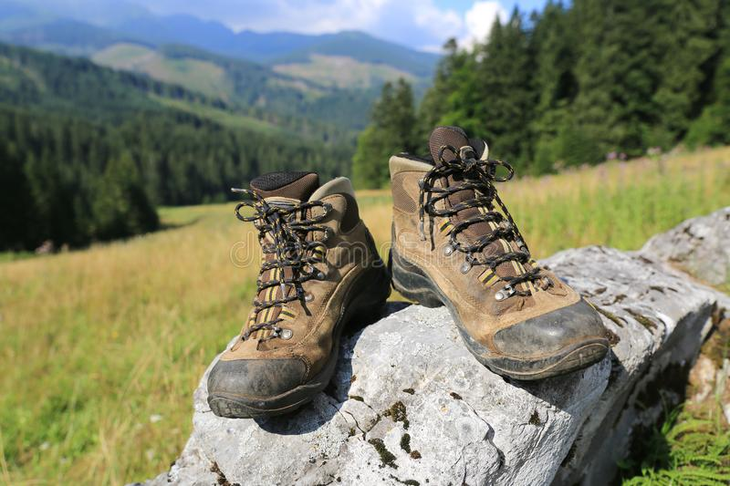 Hikers boots on stone royalty free stock images