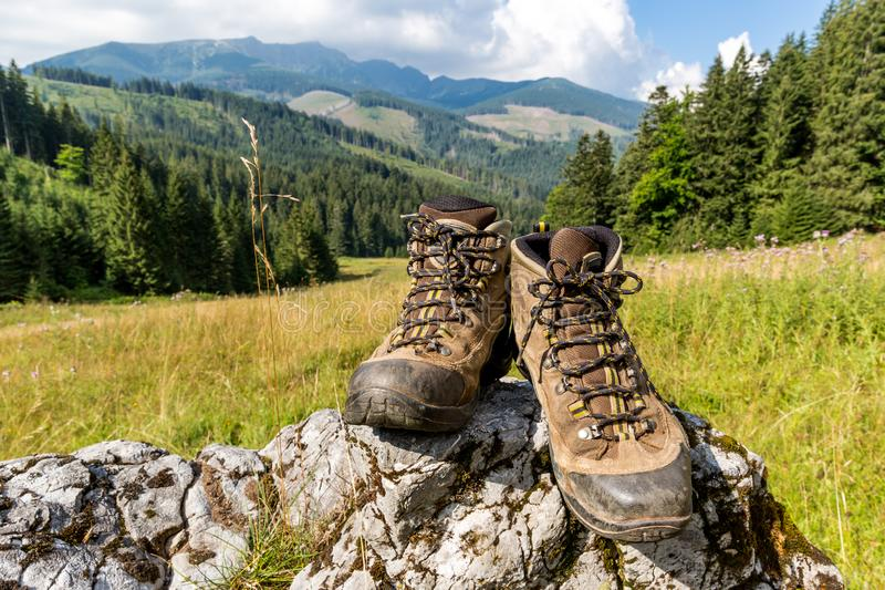 Hikers boots on stone royalty free stock photos
