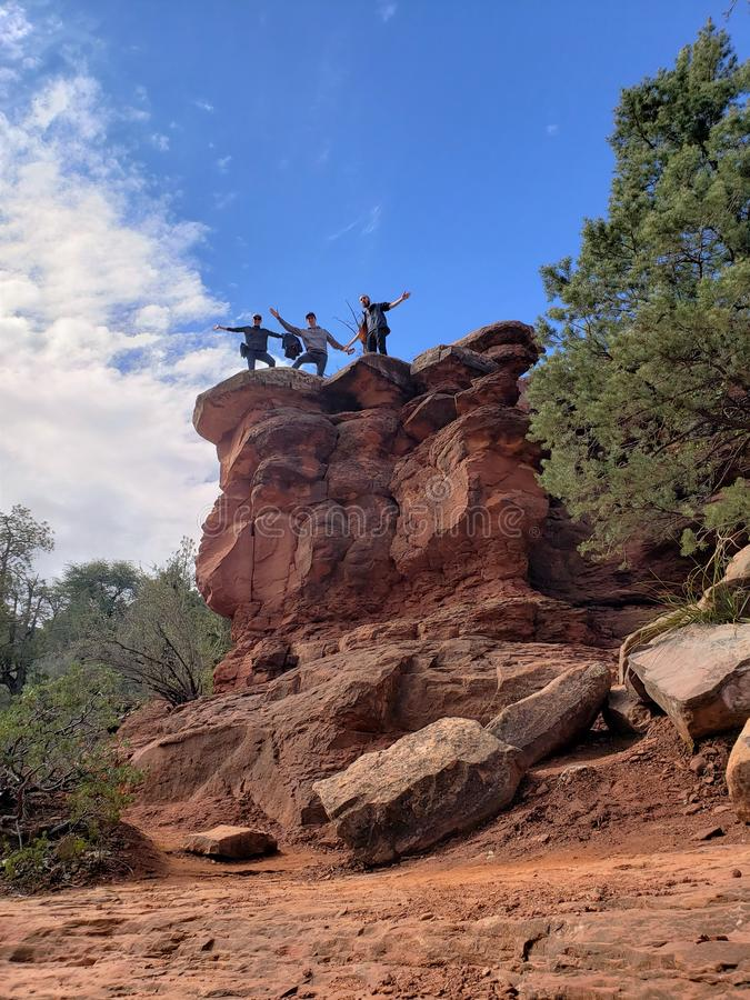 Hikers on cliff at Slide Rock State Park royalty free stock photo