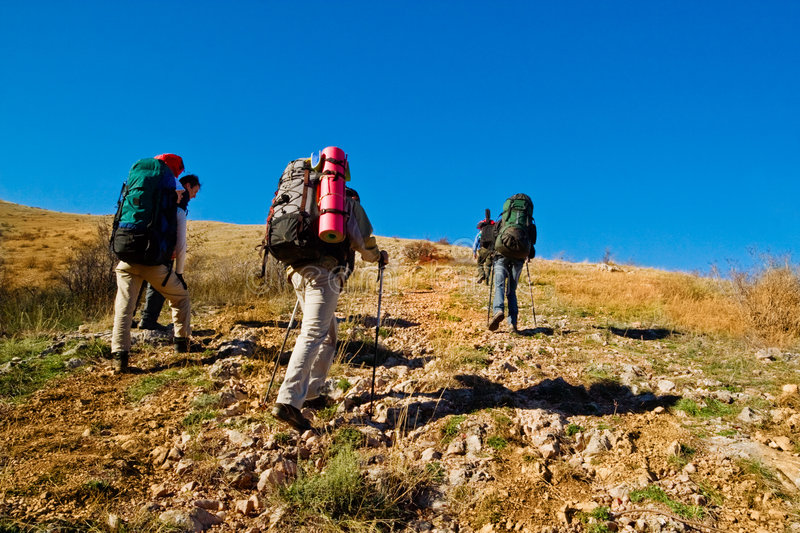 Hikers Climbing The Mountain Stock Image