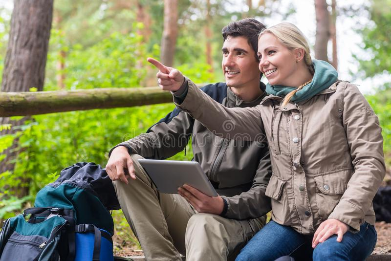 Hikers determinating their position by GPS on tablet PC stock images