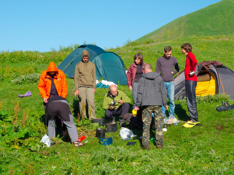 Hikers eat breakfast at the camp stock images