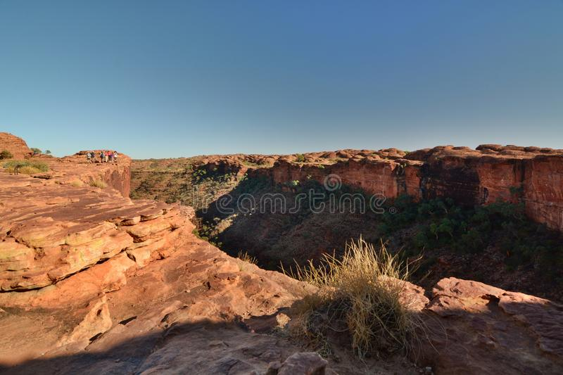 Hikers on the edge of the canyon. Kings Canyon. Watarrka National Park. Northern Territory. Australia. Kings Canyon is a canyon in the Northern Territory of stock photo