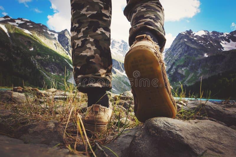 hikers go along mountain ridge stock photos