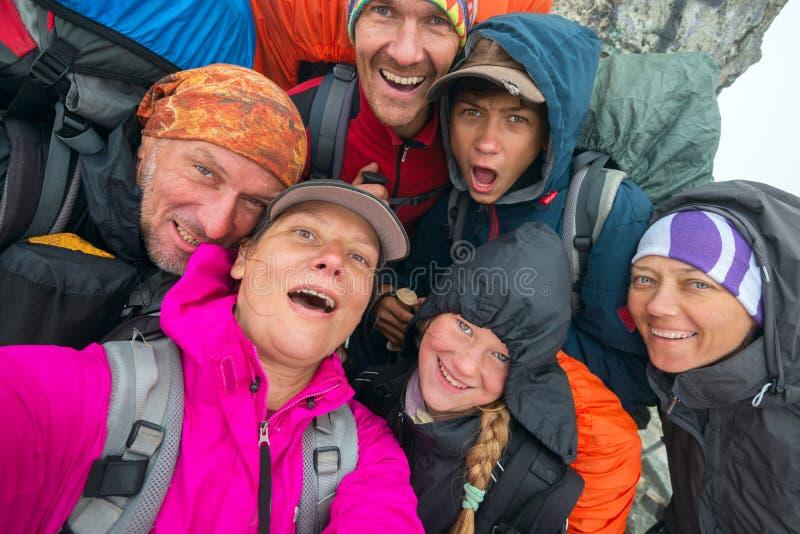 Hikers having fun and making selfie royalty free stock image