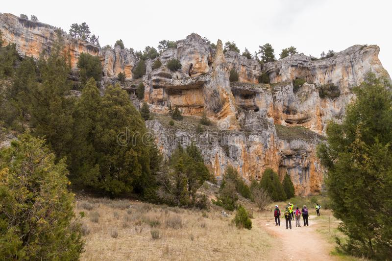 Hikers by amazing karstic mountains royalty free stock photo