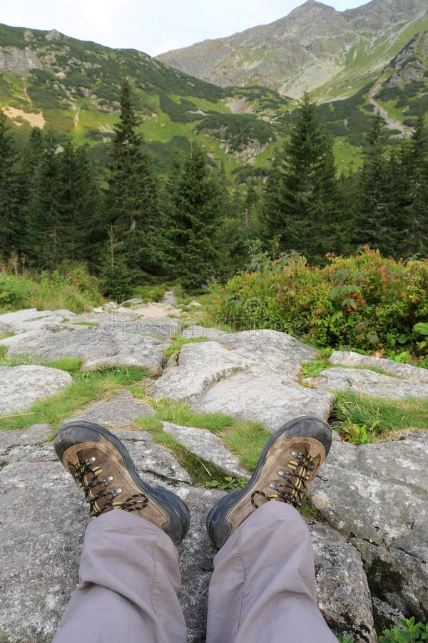Hikers legs in boots on stone royalty free stock images