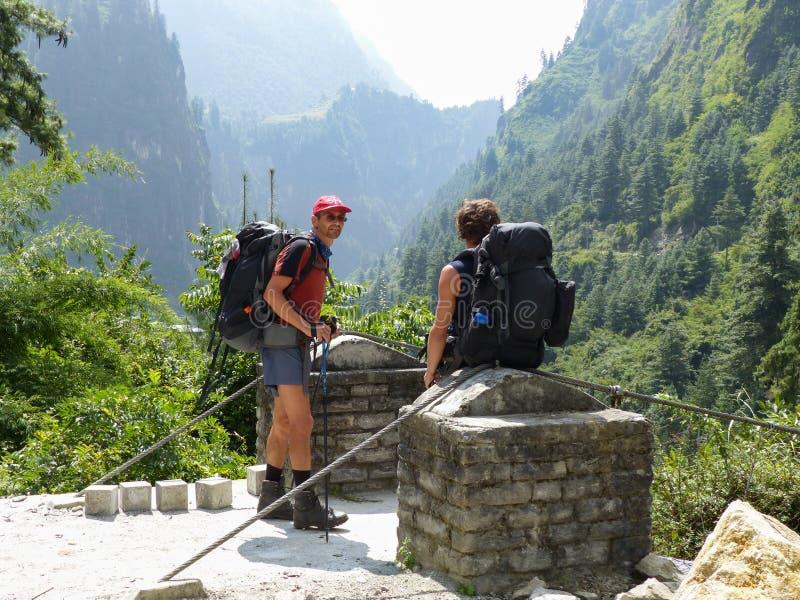 Hikers. Marsyangdi river valley - Annapurna circuit trek in Nepal royalty free stock photo