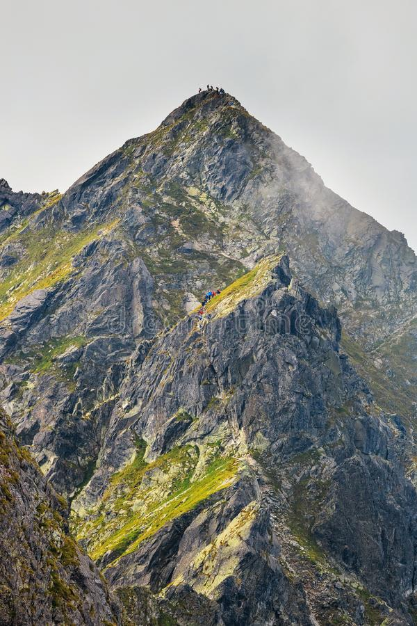 Hikers on the mountain trail in High Tatras. Hikers on the mountain trail in High Tatra Mountains, Poland stock photo
