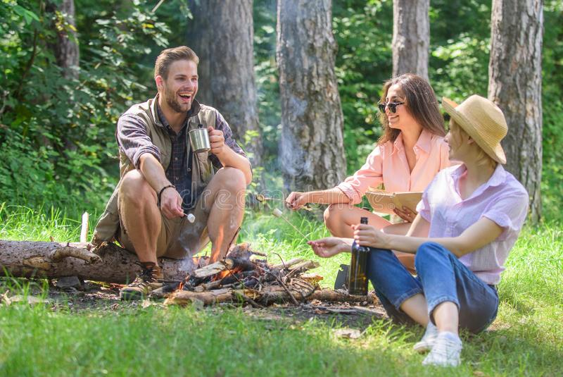 Hikers on picnic. Spend great time on weekend. Company hikers at picnic roasting marshmallows snacks eating food. Take a royalty free stock photos