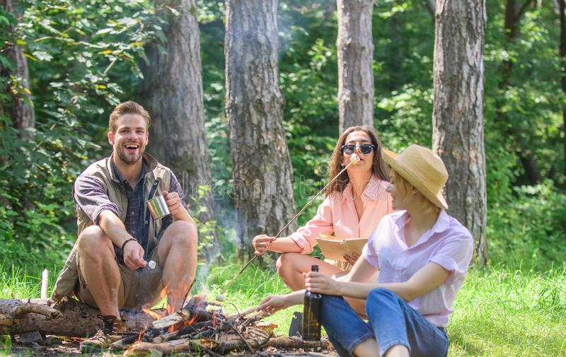 Hikers on picnic. Spend great time on weekend. Take a break to have snack. Company friends eat food snack nature. Background. Company hikers at picnic roasting stock image