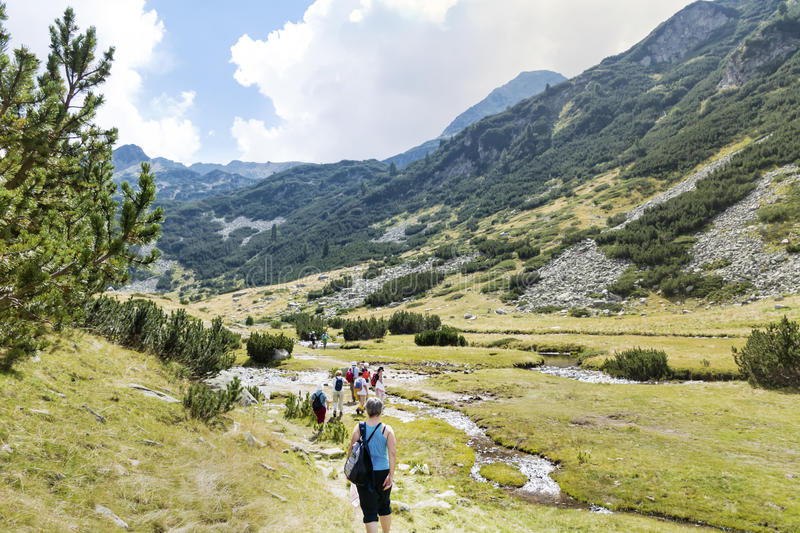 Hikers in Pirin mountain, Bulgaria stock images