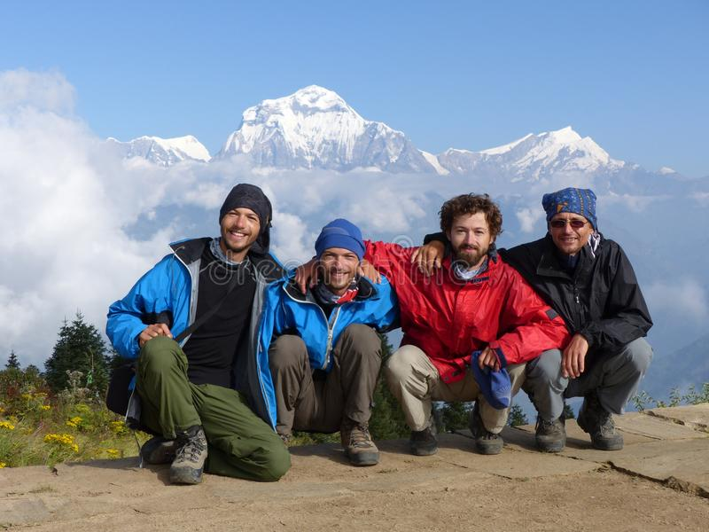 Hikers on Poon Hill, Dhaulagiri range, Nepal royalty free stock image