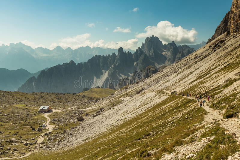 Hikers on the popular trail from Rif. Auronzo to Monte Paterno arrive at Patern. Pass to be awarded with stunning views of the 3 summits, Italy royalty free stock image