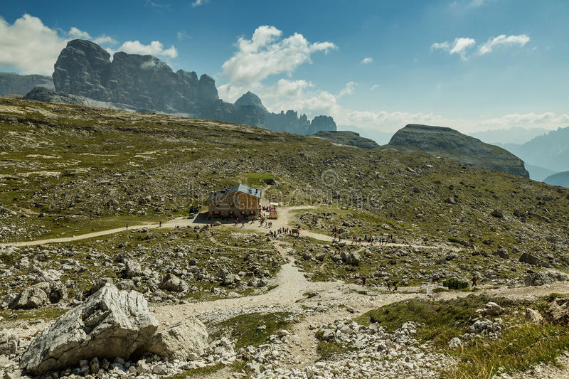 Hikers on the popular trail from Rif. Auronzo to Monte Paterno arrive at Patern. Pass to be awarded with stunning views of the 3 summits, Italy royalty free stock images