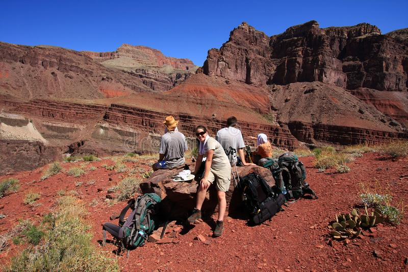 Hikers rest on the Tonto Trail in Grand Canyon National Park. stock photo