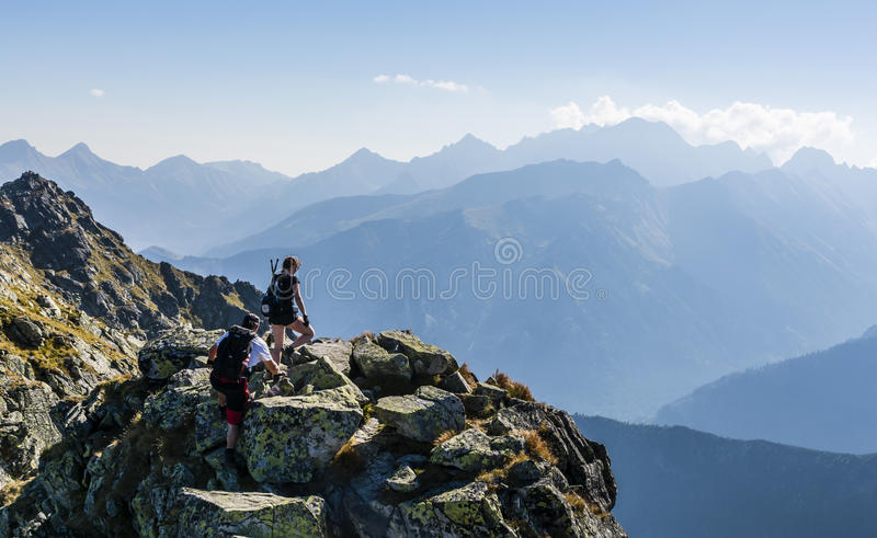 Hikers on the ridge. stock photos