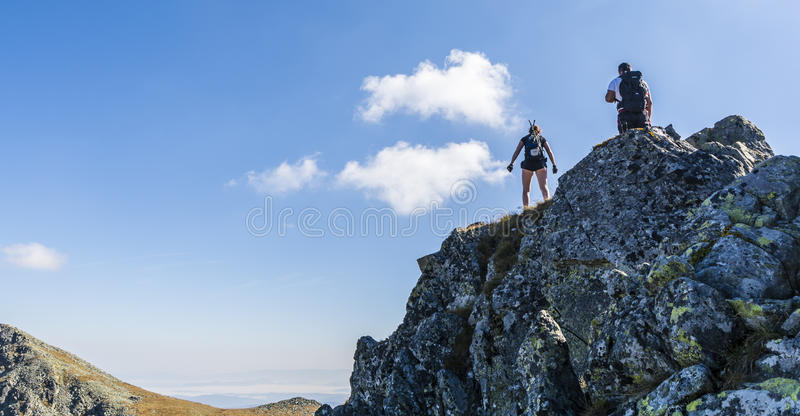 Hikers on the ridge. stock photo