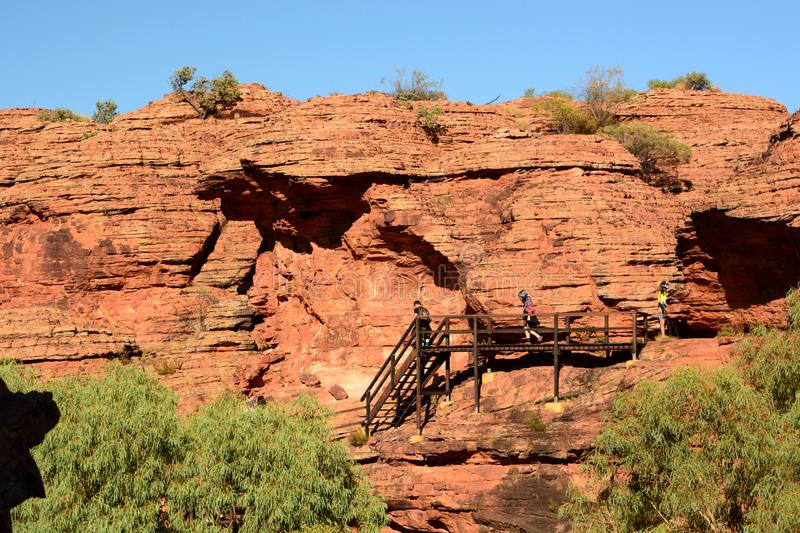 Hikers at rim walk stairway. Kings Canyon. Watarrka National Park. Northern Territory. Australia. Kings Canyon is a canyon in the Northern Territory of Australia stock photos