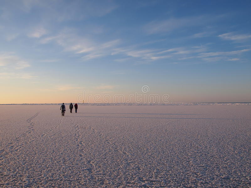Hikers on a sea ice. Vast field royalty free stock photos