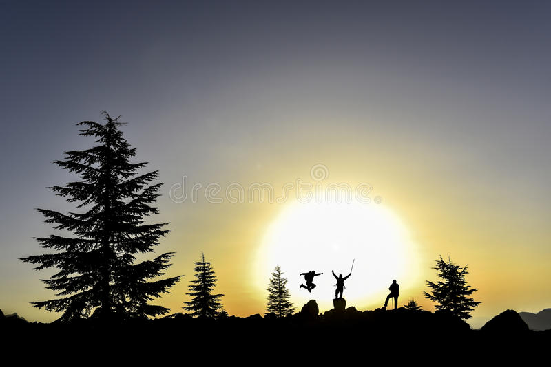 Hikers silhouette in mountain. Hikers jumping on rocks in alpine landscape silhouetted against sunset royalty free stock photos