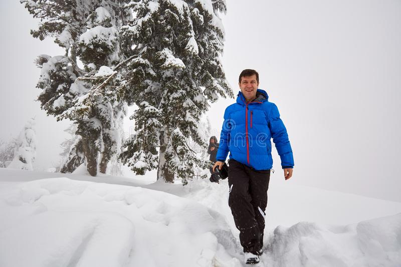 Hikers in the snowy mountains stock photos