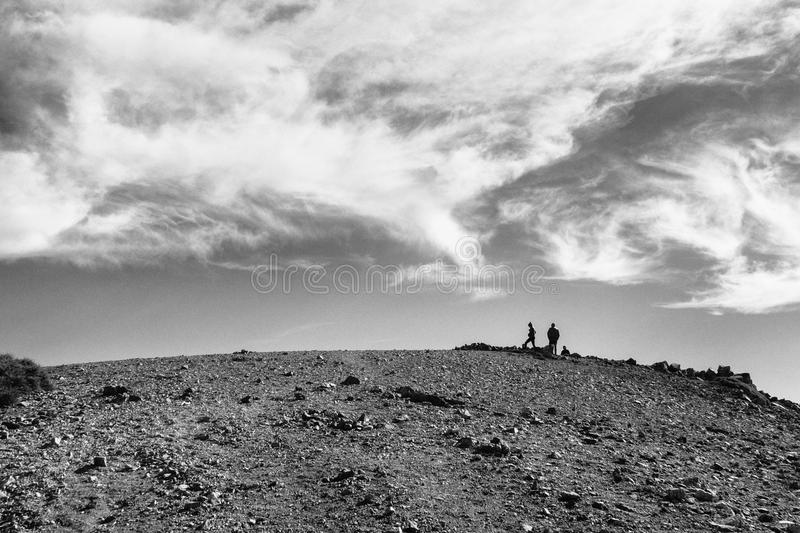 Hikers on the summit of Mt. Baldy near Los Angeles, black and white royalty free stock image