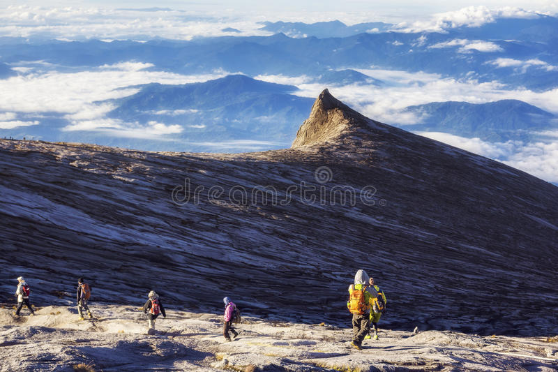 Hikers at the Top of Mount Kinabalu in Sabah, Malaysia royalty free stock photography