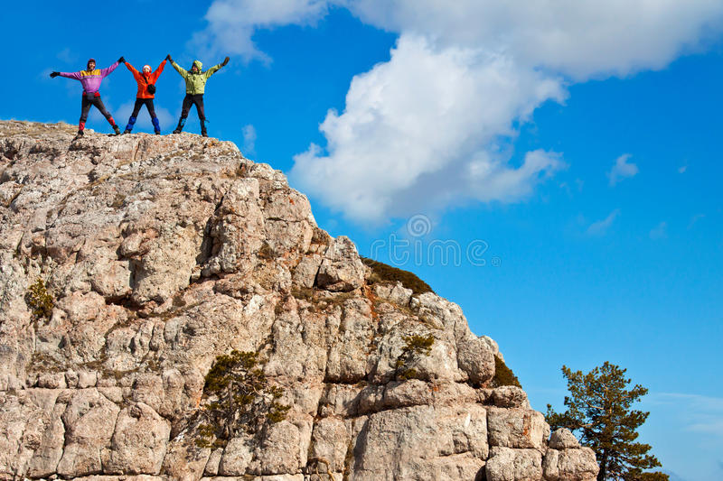 Download Hikers At The Top Of A Rock With Their Hands Up Stock Image - Image: 18976909