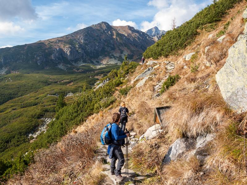 Hikers on trail at Great Cold Valley, Vysoke Tatry High Tatras, Slovakia. The Great Cold Valley is 7 km long valley, very attrac royalty free stock photography