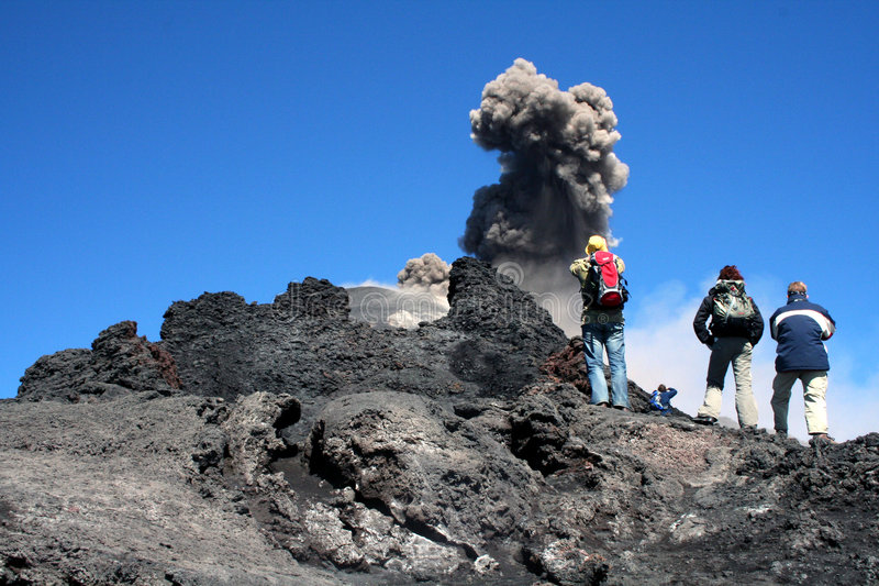 Hikers on volcano etna stock images