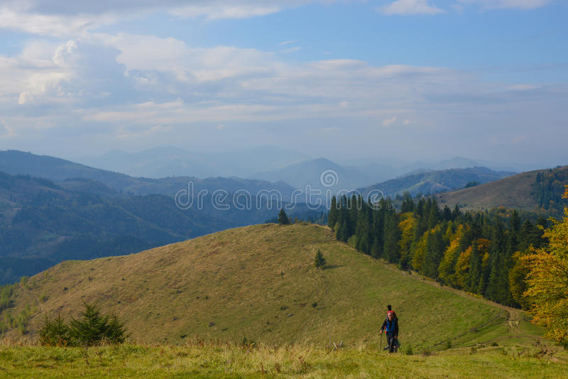 Hikers are walking to the autumn mountains . stock photos